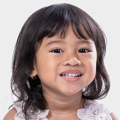 smiling happy young asian toddler at a Preschool & Daycare Serving Milton, DE, Frederica, DE, Harrington, DE, Dover, DE, Baltimore, MD