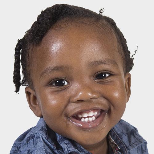 smiling toddler at a Preschool & Daycare Serving Milton, DE, Frederica, DE, Harrington, DE, Dover, DE, Baltimore, MD