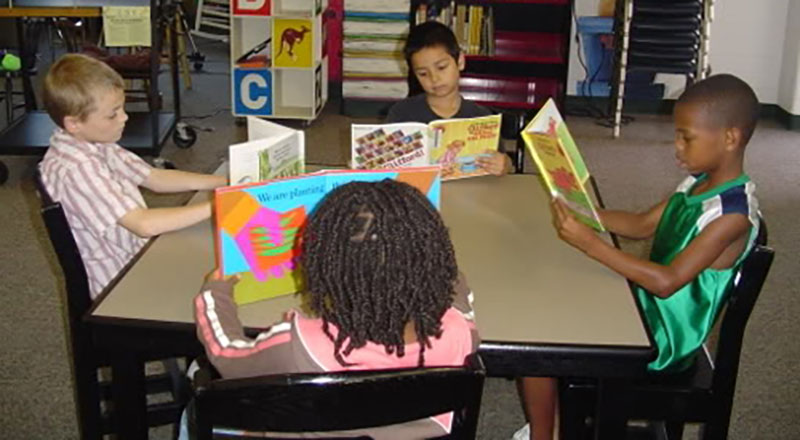 children reading together at a Preschool & Daycare Serving Milton, DE, Frederica, DE, Harrington, DE, Dover, DE, Baltimore, MD