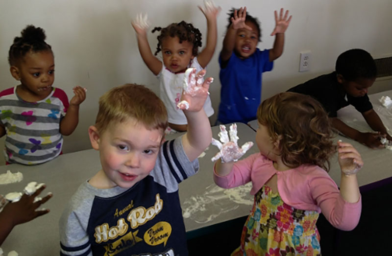 happy children playing with shaving cream at a Preschool & Daycare Serving Milton, DE, Frederica, DE, Harrington, DE, Dover, DE, Baltimore, MD