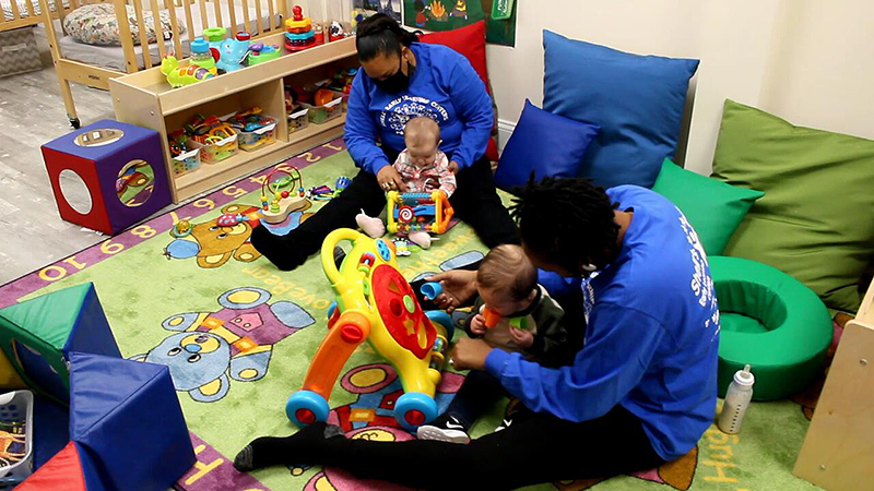 infants playing at daycare